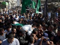 Palestinians carry the body of Hamas militant Suliman al-Garah