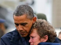 US President Barack Obama hugs North Point Marina owner Donna Vanzant