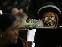"A skull is seen during a Dia de los natitas (""Day of the Skulls"") ceremon"