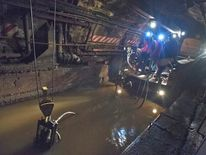 MTA employees use a pump train and work around the clock to remove seawater out of the L train's tunnel under the East River in the aftermath of Hurricane Sandy