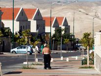 Israeli man walks on a pavement in a West Bank Jewish settlement near Jerusalem