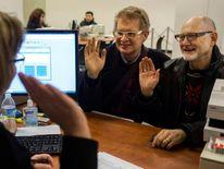 Two Washington residents obtain their marriage license in Seattle, Washington