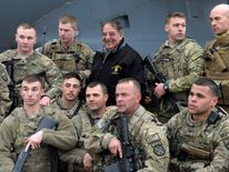 U.S. Defense Secretary Panetta poses with troops before boarding his plane back to Washington at Kabul International Airport in Kabul