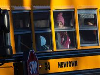 Children from Sandy Hook Elementary School are seen on a school bus making their way to their new school in Monroe as they leave Newtown