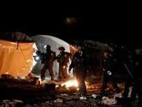 Israeli police removed scores of Palestinians from their protest camp at the E1 site.