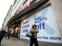People walk past a HMV store in central London