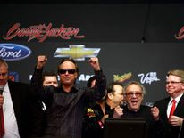 George Barris cheers as his original Batmobile was sold for $4,200,000 during the Barrett-Jackson collectors car auction in Scottsdale, Arizona