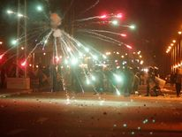 Protesters throw fireworks on police in front of the presidential palace, in Cairo