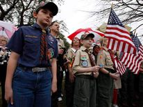 A crowd of Scouts, parents and supporters gather during a prayer vigil at the Boy Scouts of America headquarters in Irving
