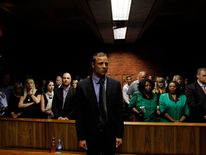 """Blade Runner"" Oscar Pistorius awaits the start of court proceedings."