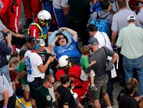 Rescue workers attend to the injured