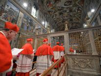 Cardinals enter the Sistine Chapel to begin the conclave in order to elect a successor to Pope Benedict at the Vatican