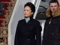 Chinese First Lady Peng Liyuan takes part in a welcoming ceremony upon her arrival with President Xi Jinping at Moscow's Vnukovo airport