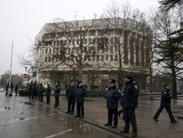 Ukrainian police stand guard in front the Crimean parliament building in Simferopol