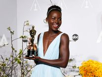 "Lupita Nyong'o poses with her award for best supporting actress for her role in ""12 Years a Slave"" at the 86th Academy Awards in Hollywood, California"