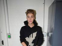 Handout shows Canadian pop singer Justin Bieber in police custody in Miami Beach, Florida