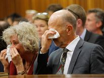 Uncle of South African Olympic and Paralympic sprinter Pistorius wipes his tears as the athlete gives evidence during his trial at the high court in Pretoria