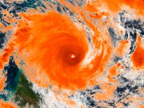 Tropical Cyclone Ita is seen just off-shore near Cape Flattery, Queensland, Australia in this NOAA image taken by the Suomi NPP satellite's VIIRS instrument