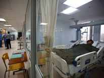 Dawa Tashi Sherpa lies on bed of the Intensive Care Unit at Grandi International Hospital after he was rescued and airlifted from the avalanche site at Mount Everest in Kathmandu