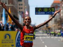 Kenya's Rita Jeptoo reacts after winning the women's division at the 118th running of the Boston Marathon