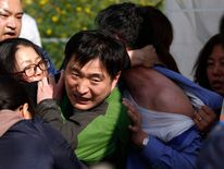 Angry family members of passengers on capsized South Korean ferry drag officials out from office to demand for faster and more efficient rescue work in Jindo