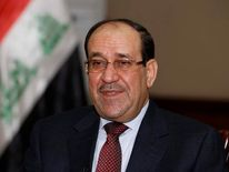 File photo shows Iraq's Prime Minister al-Maliki speaking during an interview with Reuters in Baghdad.