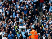 Manchester City's captain Vincent Kompany celebrates after scoring against West Ham United during their English Premier League soccer match in Manchester