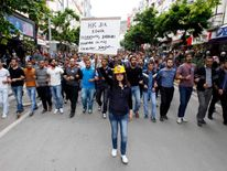 Protesters march as they demonstrate to blame the ruling AK Party government for the mining disaster in Soma