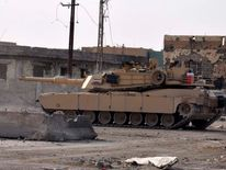 A tank of the Iraqi security forces patrols during a search for ISIL militants in Ramadi