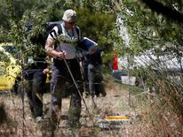 Scotland Yard detectives work with a ground-penetrating radar on an area during the search for missing British girl Madeleine McCann in Praia da Luz