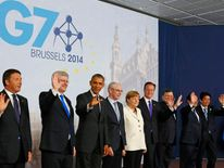 Leaders pose for a group photo during a G7 meeting at European Council headquarters in Brussels