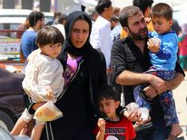 People flee Mosul after militants seize Mosul in Iraq