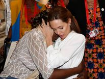 Actress and Special Envoy of the United Nations High Commissioner for Refugees, Angelina Jolie, hugs Neema Namadamu of the Democratic Republic of Congo a the 'End Sexual Violence in Conflict' summit in London