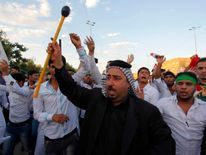 People shout slogans in support for the call to arms by Grand Ayatollah Ali al-Sistani in Najaf.
