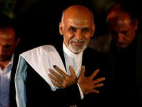 Afghan presidential candidate Ashraf Ghani Ahmadzai attends a news conference in Kabul.