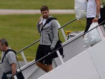 England's Gerrard arrives back from the 2014 World Cup in Brazil at Manchester airport