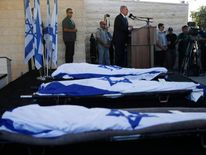 Israeli Prime Minister Netanyahu eulogizes the three Israeli teens who were abducted and killed in the occupied West Bank, during their joint funeral in the Israeli city of Modi'in