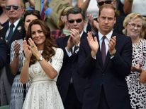 Britain's Prince William and his wife Catherine, Duchess of Cambridge applaud on Centre Court after the men's singles quarter-final tennis match between Andy Murray and Grigor Dimitrov at the Wimbledon Tennis Championships, in London