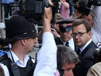 Former Editor of the News of the World Andy Coulson arrives for sentencing at the Old Bailey court house in London