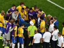 Brazil's coach Luiz Felipe Scolari and his team huddle after their 2014 World Cup semi-finals against Germany at the Mineirao stadium in Belo Horizonte