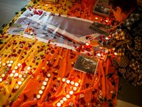 Woman lights candles at a memorial for victims of the downed Malaysia Airlines flight MH17 in Kuala Lumpur