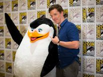 "Actor Cumberbatch, who voices ""Classified"", poses with the character ""Skipper"" at a press line for the movie ""Penguins of Madagascar"" during the 2014 Comic-Con International Convention in San Diego"