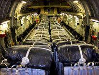 Water bundles align a C-17 Globemaster III cargo plane at Al Udeid Air Base, Qatar, prior to a humanitarian air drop over Iraq