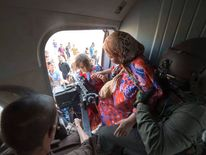 Women and children are evacuated in a military helicopter by Iraqi forces from Amerli, north of Baghdad