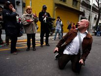 A fan reacts outside the clinic where Argentine musician Cerati died today at the age of 55 in Buenos Aires