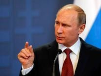 Russian President Putin addresses during a joint news conference with Hungarian Prime Minister Orban in Budapest