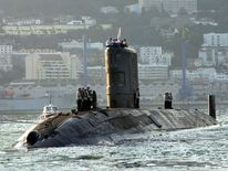 BRITISH SAILORS STAND ON SUBMARINE TIRELESS AS THEY LEAVE GIBRALTAR.