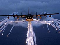 MC130E COMBAT TALON DROPS FLARES.