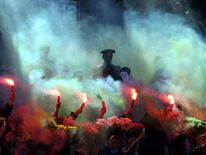 Supporters of Russian Zenit St.Petersburg soccer club celebrate a goal against CSKA Moscow during ...