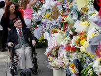 WWII veteran Donald Hunt looks at messages and flowers left for British soldier Lee Rigby